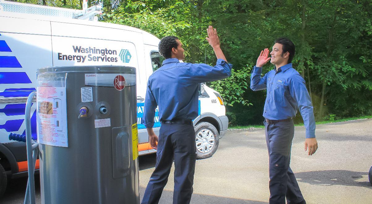 Technicians finishing an HVAC job in Seattle